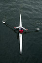 Overhead view of female in red shirt rowing single seat boat seattle usa may an a a a white person scull on dark water Stock Images