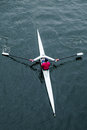 Overhead view of female in red shirt rowing single seat boat seattle usa may an a a a white person scull on dark water Royalty Free Stock Photography