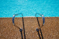Overhead view of inviting aqua swimming pool  steps Royalty Free Stock Photo