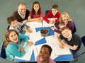 Overhead View Of Schoolchildren Working Together Stock Image