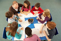 Overhead View Of Schoolchildren Working Together Royalty Free Stock Photos