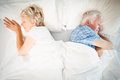 Overhead view of sleeping tired couple senior on bed at home Royalty Free Stock Photography
