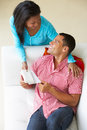 Overhead view of woman giving man gift smiling to each other Royalty Free Stock Photos
