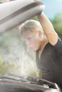 Overheat portrait of young beautiful woman with broken car Royalty Free Stock Photo
