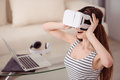 Overjoyed girl wearing virtual reality device new view cheerful pleasant smiling and Royalty Free Stock Photography
