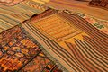 Overlapping carpets with intricate kurdish patterns in rug store in istanbul turkey Royalty Free Stock Photos