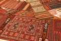 Overlapping carpets with intricate kurdish patterns in rug store in istanbul turkey Stock Photo