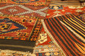 Overlapping carpets with intricate kurdish patterns in rug store in istanbul turkey Stock Images