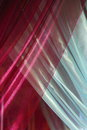 Overlapping silk curtains image of luxurious red and blue Royalty Free Stock Photos
