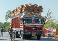 Overloaded dump truck nagaur india circa february filled with jute bags on the road Royalty Free Stock Photos