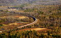 Overlook of a train travelling in the immense forest passenger Stock Photography