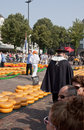 Overlooking the cheese market in alkmaar holland tourists are looking at spectacle of netherlands this large year old located on Royalty Free Stock Photography