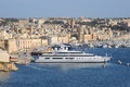 Overlooking millionaire s yachts and the ancient town of birgu grand harbour valetta malta Stock Photo