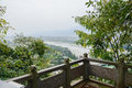 Overlooking of riverside landscape from stone balustrade in clou mountainside cloudy and foggy winter afternoon dujiangyan china Stock Images