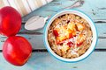 Overnight breakfast oats with peach and coconut, overhead scene Royalty Free Stock Photo