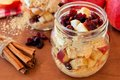Overnight oats with apples and cranberries in a mason jar Royalty Free Stock Photo