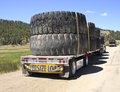 Oversize load truck a large trailer carrying an of used tires Stock Image