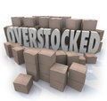 Overstocked words cardboard boxes warehouse inventory the word in the middle of a of to symbolize an oversupply or surplus of Stock Images