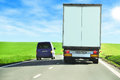 Overtaking personal car a truck Stock Photography