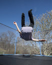 Overturn on trampoline child doing an a outdoors Royalty Free Stock Photo