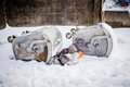 Overturned garbage containers during strong and snowy winter Stock Photography