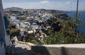 Overview of fira on santorini greece with tourists climbing steps Stock Images