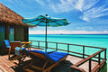 Overwater villa balcony overlooking lagoon Stock Photo
