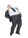 Overweight man with back pain Royalty Free Stock Photography