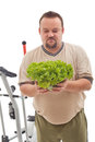 Overweight man not happy about his new diet Royalty Free Stock Photo