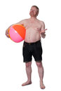 Overweight middle aged man with beach ball checks for rain bearded holds out hand checking isolated on white Stock Photos
