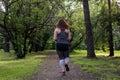 Overweight woman back running. Weight loss concept