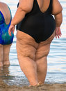 Overweight woman on the beach unrecognizable person Stock Photos
