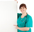 Overweight woman doctor showing something on sign Royalty Free Stock Photography