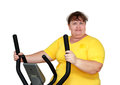Overweight woman exercising on trainer Royalty Free Stock Images