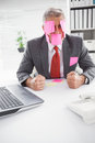 Overwhelmed businessman with sticky notes on head in his office Royalty Free Stock Photos