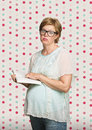 Overwhelmed pregnant woman in eyeglasses reading a book Royalty Free Stock Photos