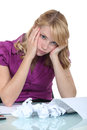 Overwhelmed secretary having a headache Royalty Free Stock Photos