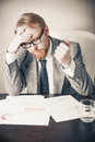 Overwhelmed tired man at work Stock Photography
