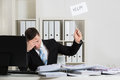 Overworked Accountant Holding Help Sign At Desk Royalty Free Stock Photo