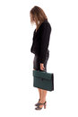 Overworked business woman carring her briefcase Royalty Free Stock Photo