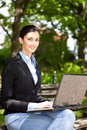 Overworked businesswoman in nature Royalty Free Stock Photos