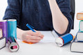 Overworked student with energy drinks empty cans writing the notes Royalty Free Stock Photos