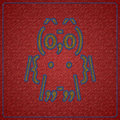 Owl ascii art pattern digitally sewed onto jeans fabric Royalty Free Stock Image