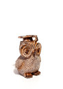 Owl figurine with graduation hat on the white background Royalty Free Stock Photo