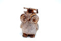 Owl figurine with graduation hat on the white background Stock Photos