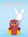 An owl is holding an Easter bunny from a paper on a stick. Vecto