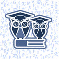 Owl with Mortarboard and book against the blue alphabet