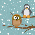 An owl and a penguin on a tree Royalty Free Stock Photos