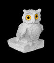 Owl statuette of white on black background Stock Images
