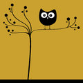 Owl in tree on yellow background Stock Photos